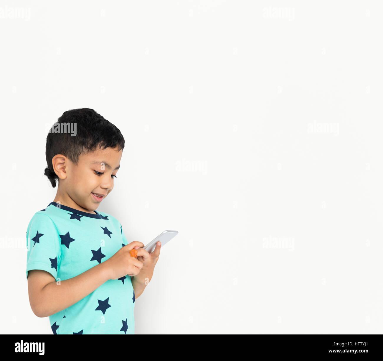 Little boy studio isolated with phone - Stock Image