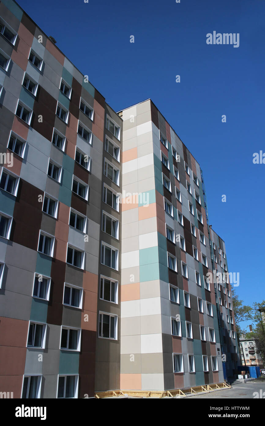 Checkered exterior multistory building, modern architecture - Stock Image