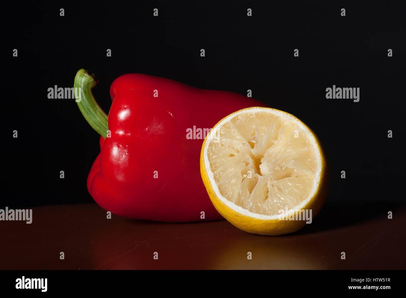 Red pepper and lemon. - Stock Image