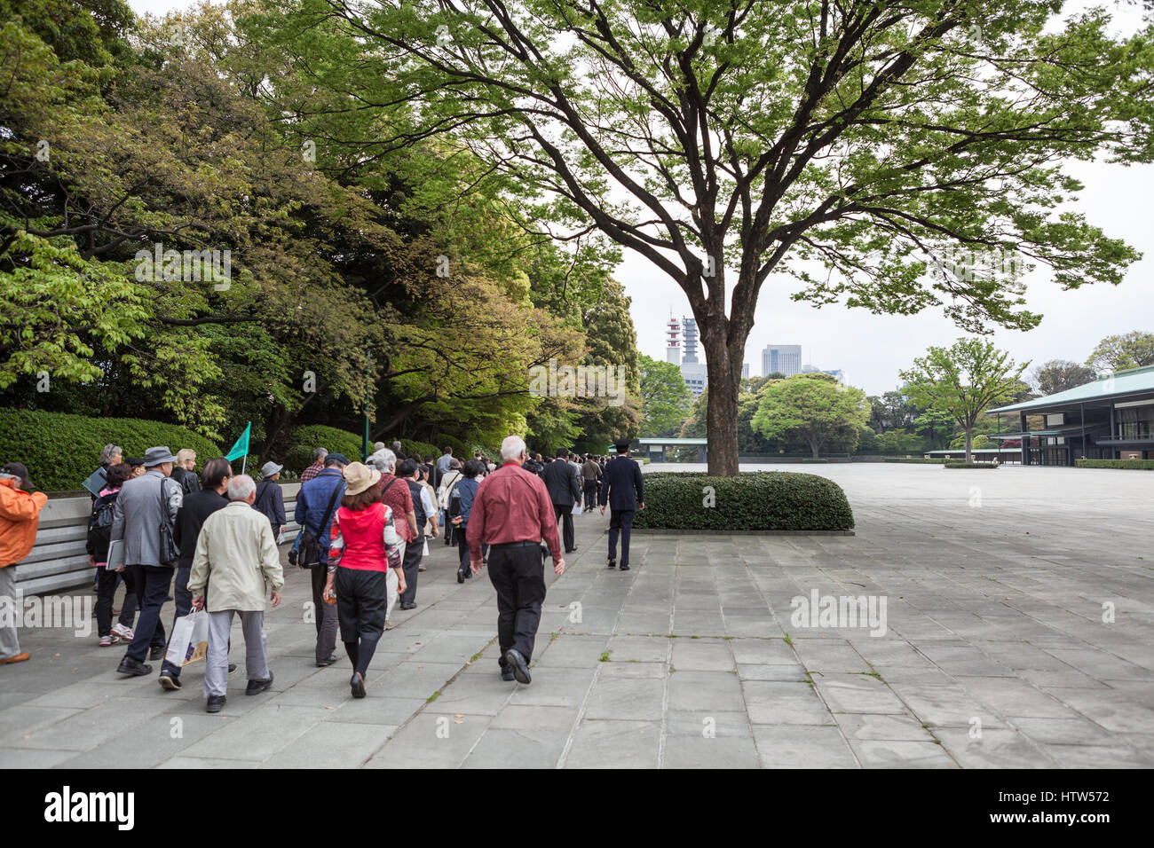 TOKYO, JAPAN - CIRCA APR, 2013: Group of visitors follow up to guide to Kyuden Totei Plaza near the Chowaden Reception - Stock Image