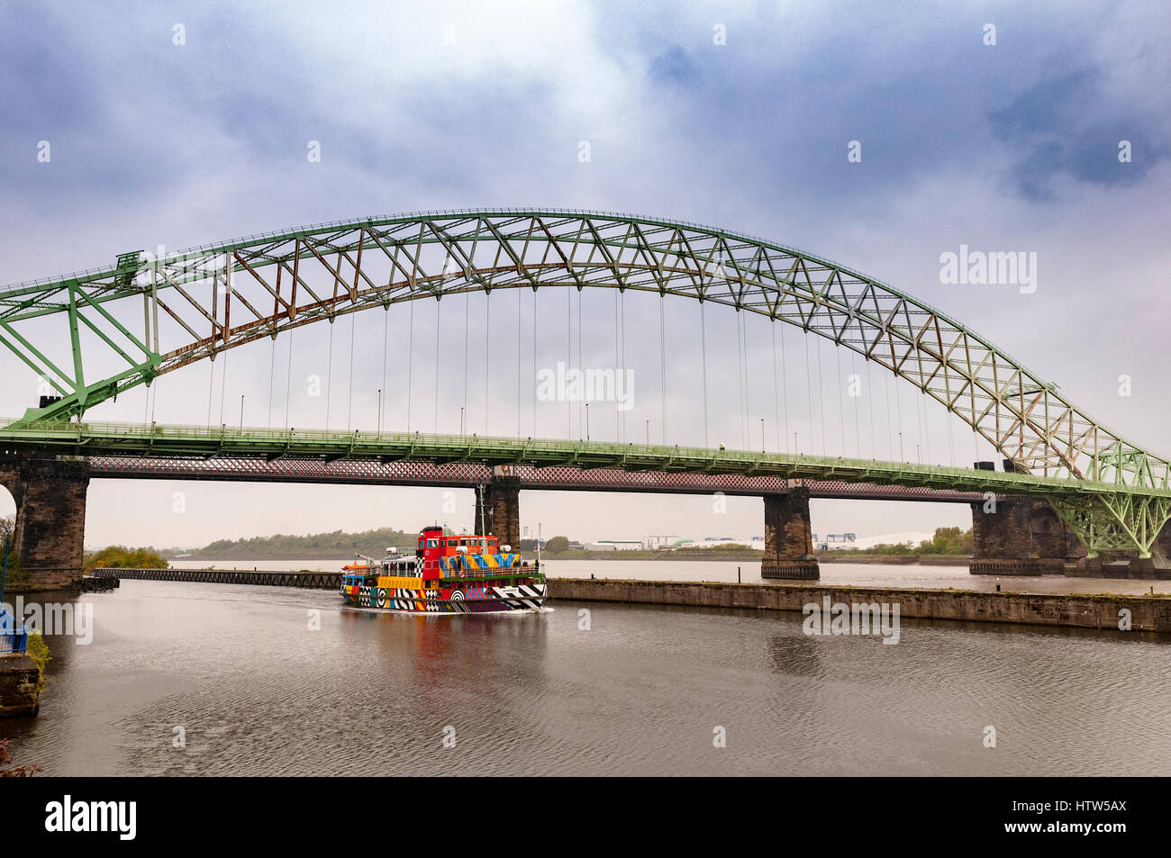 Merseyferries Dazzle ferry Snowdrop on the Manchester Ship Canal cruise.Runcorn Queensway Bridge. - Stock Image