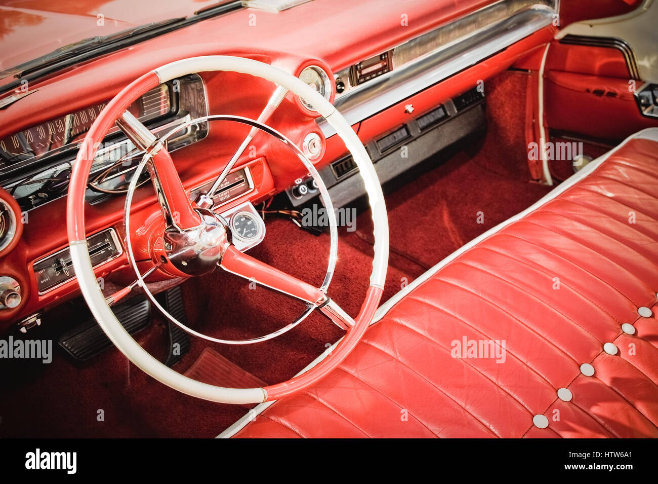 Classic American Car Interior With Red Leather Upholstery And Matching  Dashboard