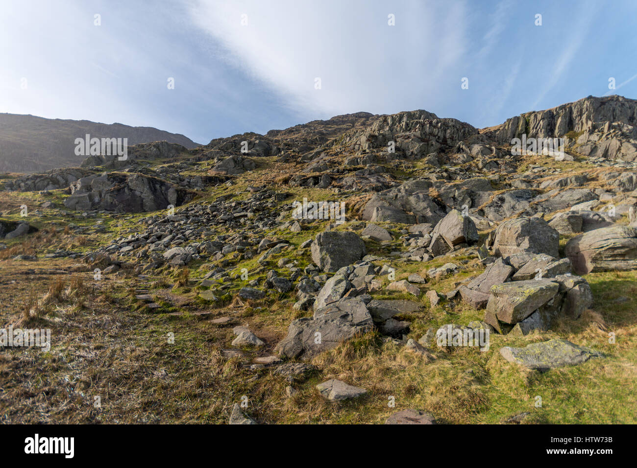 The sides of Red Screes is a craggy mountainside strewn with rocks - Stock Image