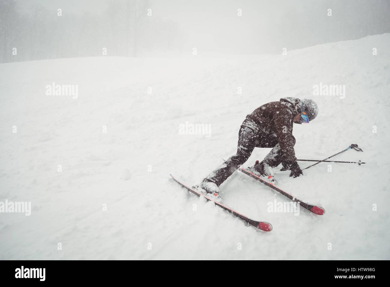 Ski fail of a man - Stock Image