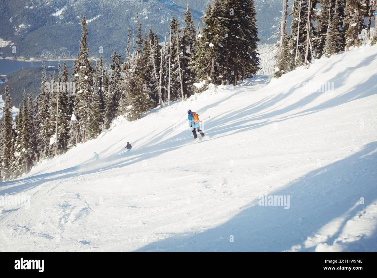 Skier skiing on snowy mountains - Stock Image