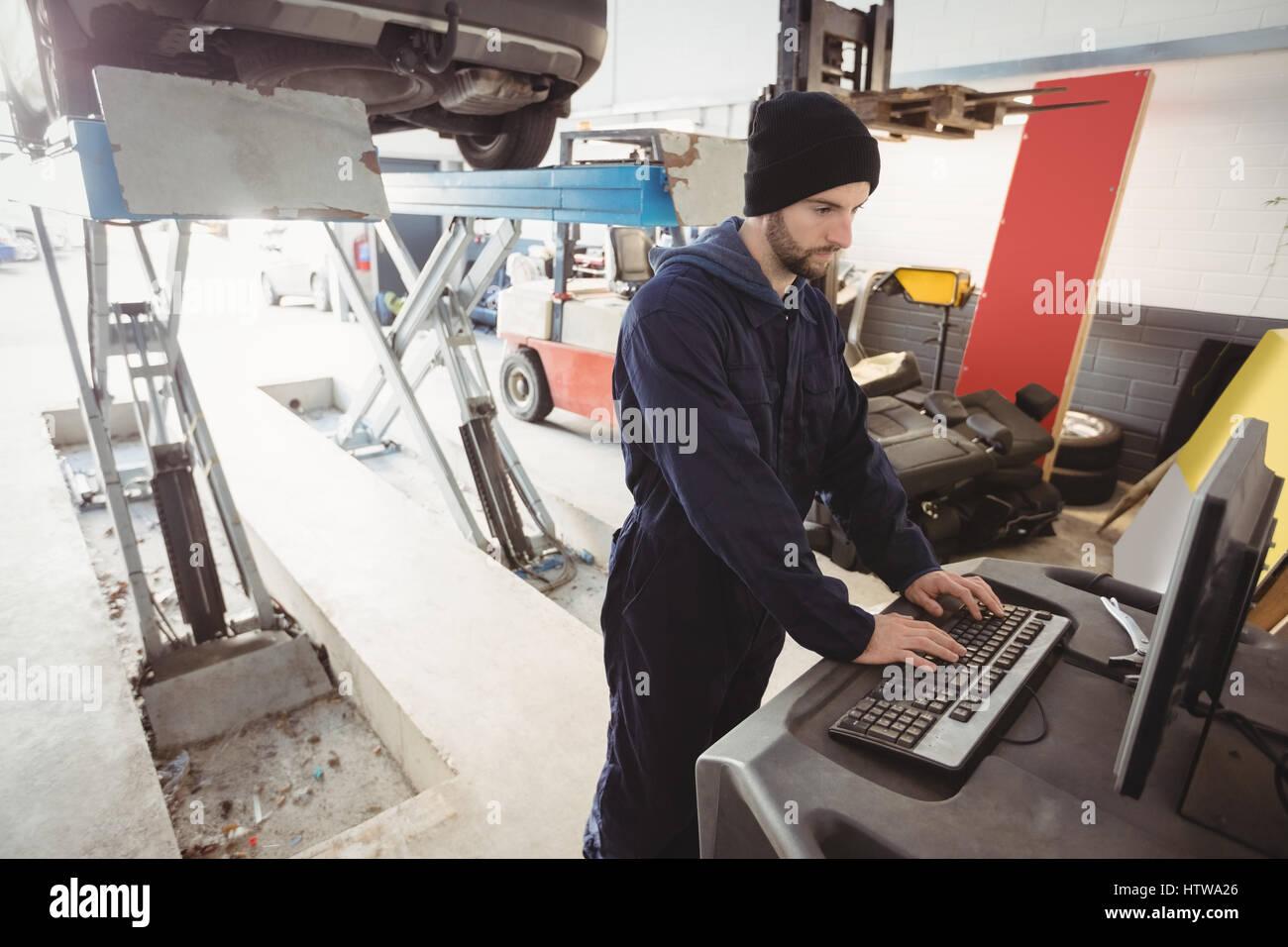 Mechanic working on personal computer - Stock Image