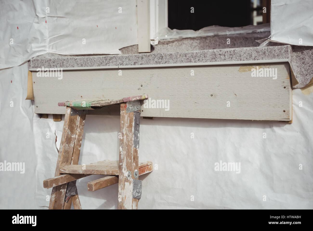 Stepladder against building under renovation Stock Photo