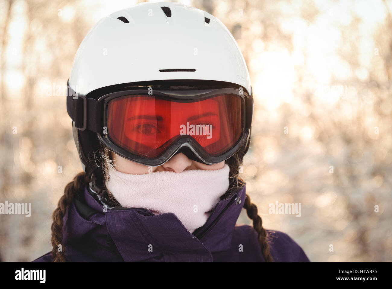 Woman in ski goggles and jacket - Stock Image