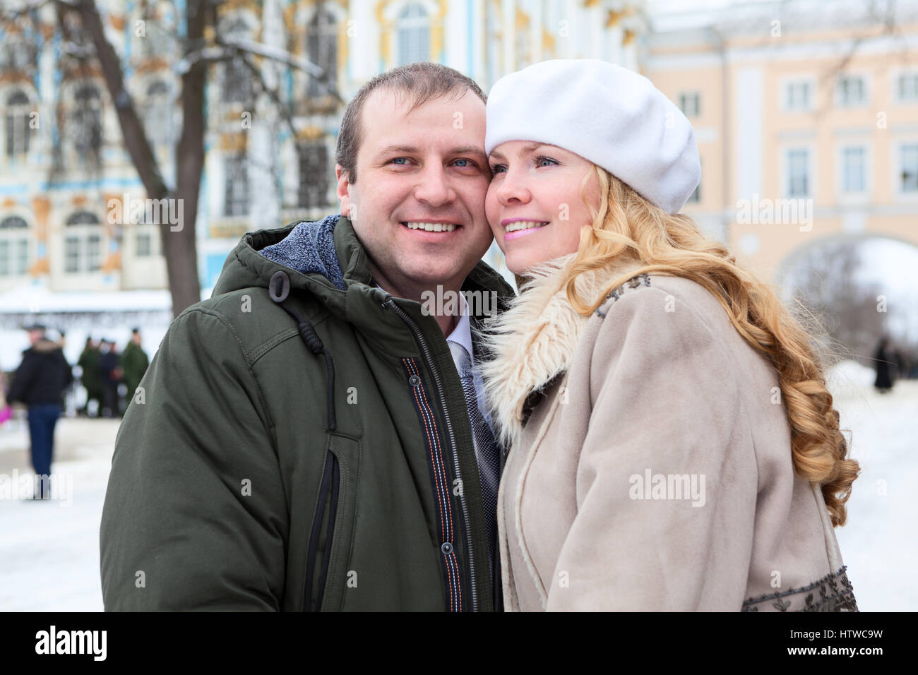 Married Caucasian couple touch each other cheek to cheek at frost, winter season. Russia - Stock Image