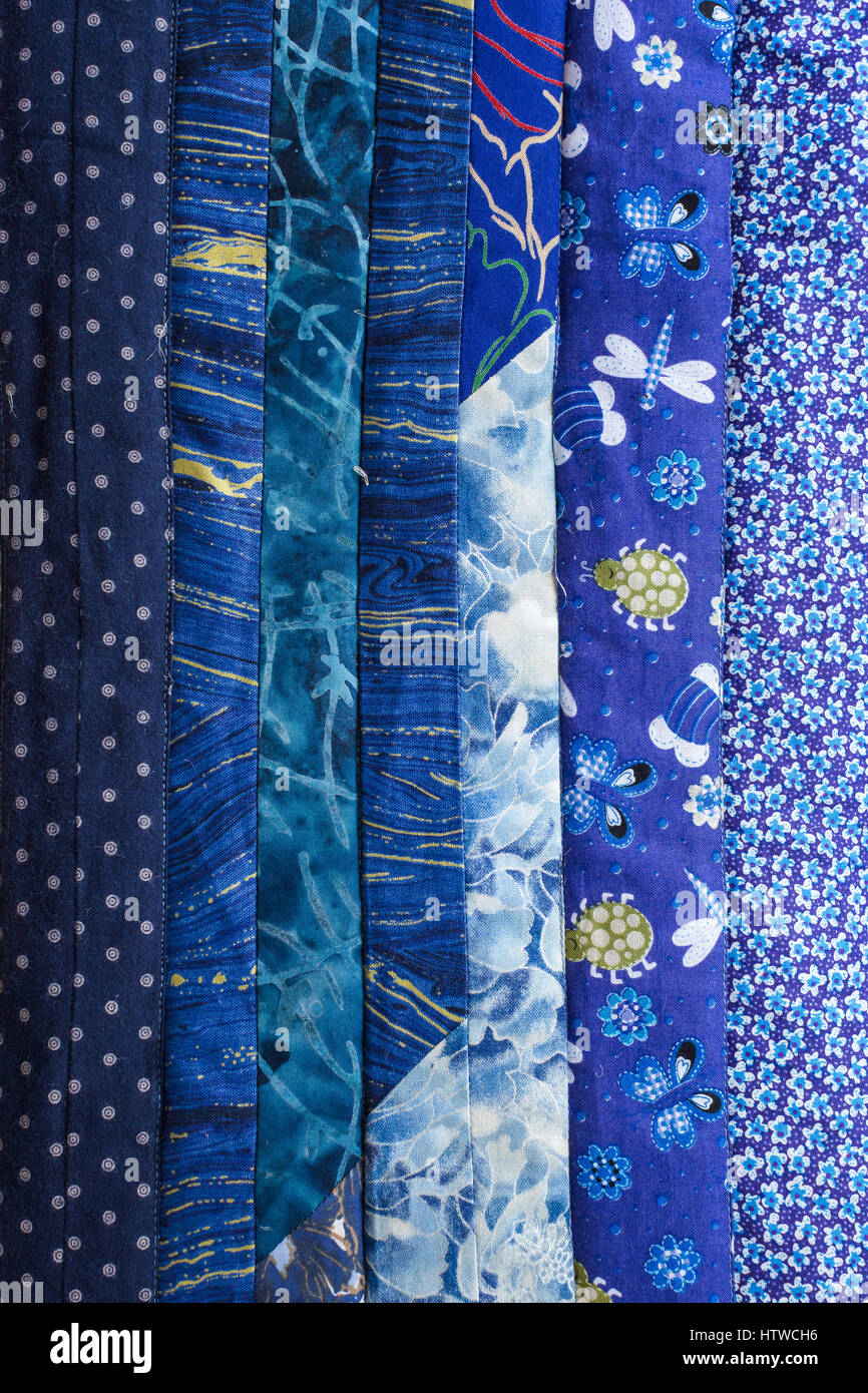 Part of color patchwork quilt as background. Colorful Scrappy blanket. Handmade. Trendy color concept. Kit of blue - Stock Image