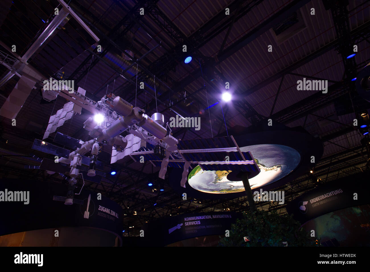 Satellite and International Space Station ISS model in space center exhibition - Stock Image