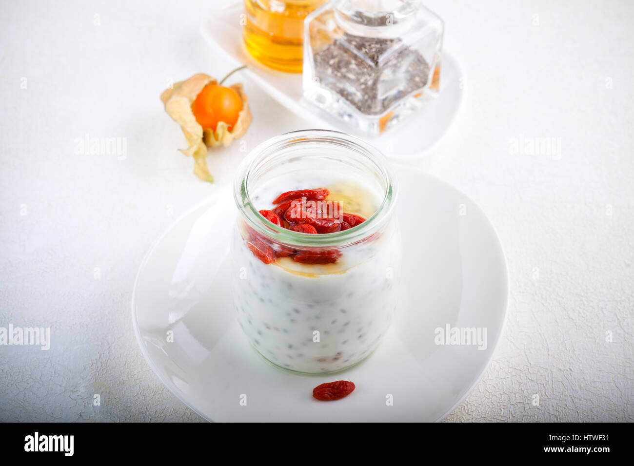Yoghurt with goji berries, chia seeds and honey - Stock Image