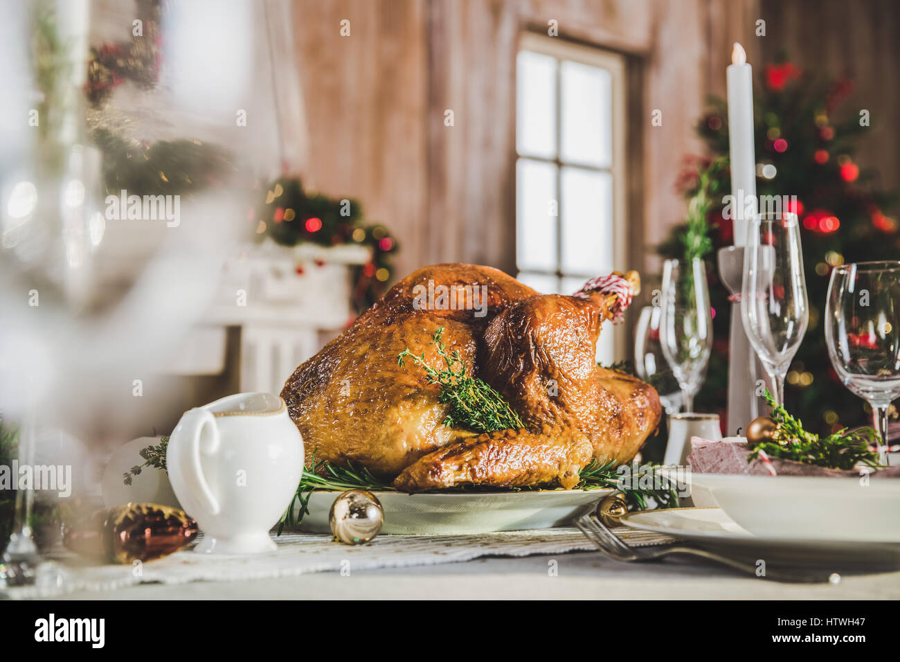 Delicious roasted turkey on served holiday table - Stock Image