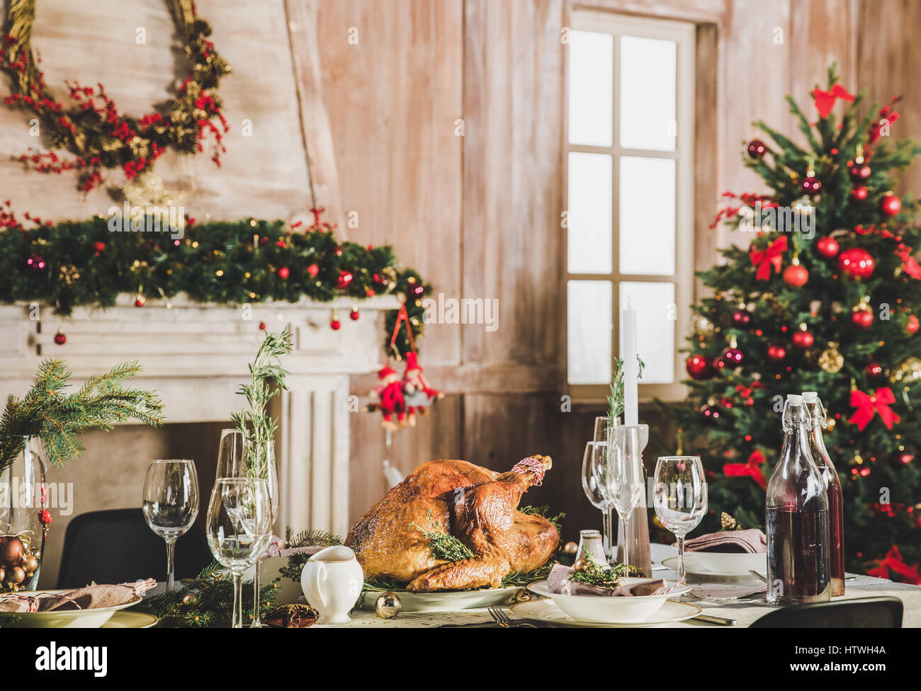 Delicious roasted turkey on served holiday table decorated for Christmas - Stock Image