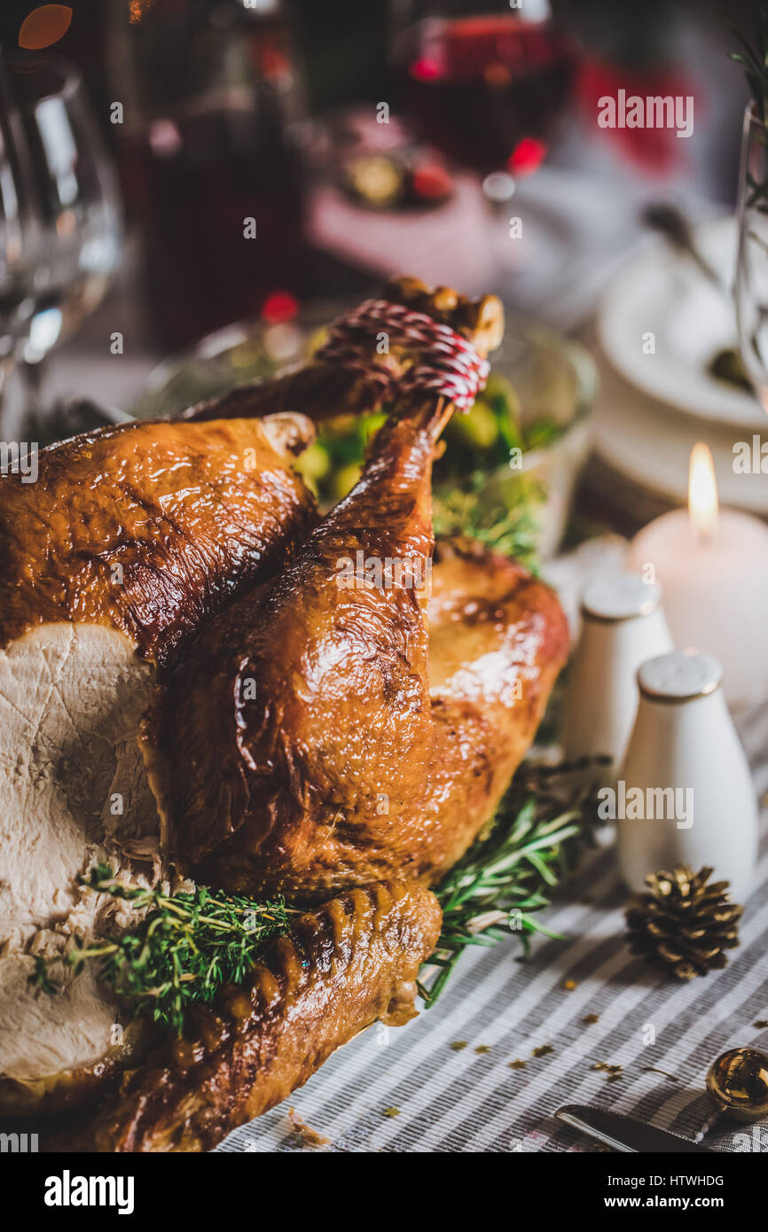 Delicious roasted turkey on served for Christmas table - Stock Image