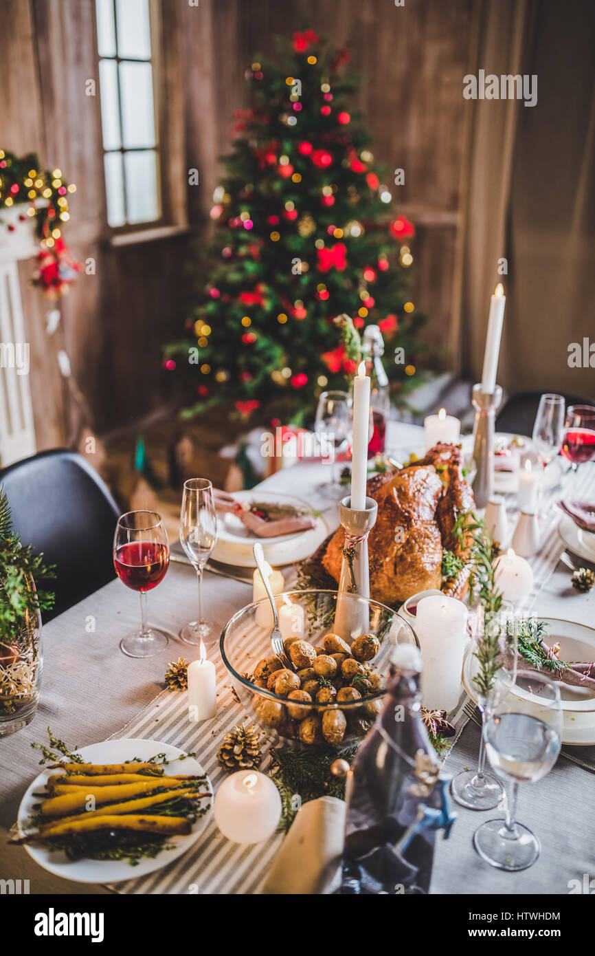 Delicious roasted turkey and vegetables on served for Christmas table - Stock Image