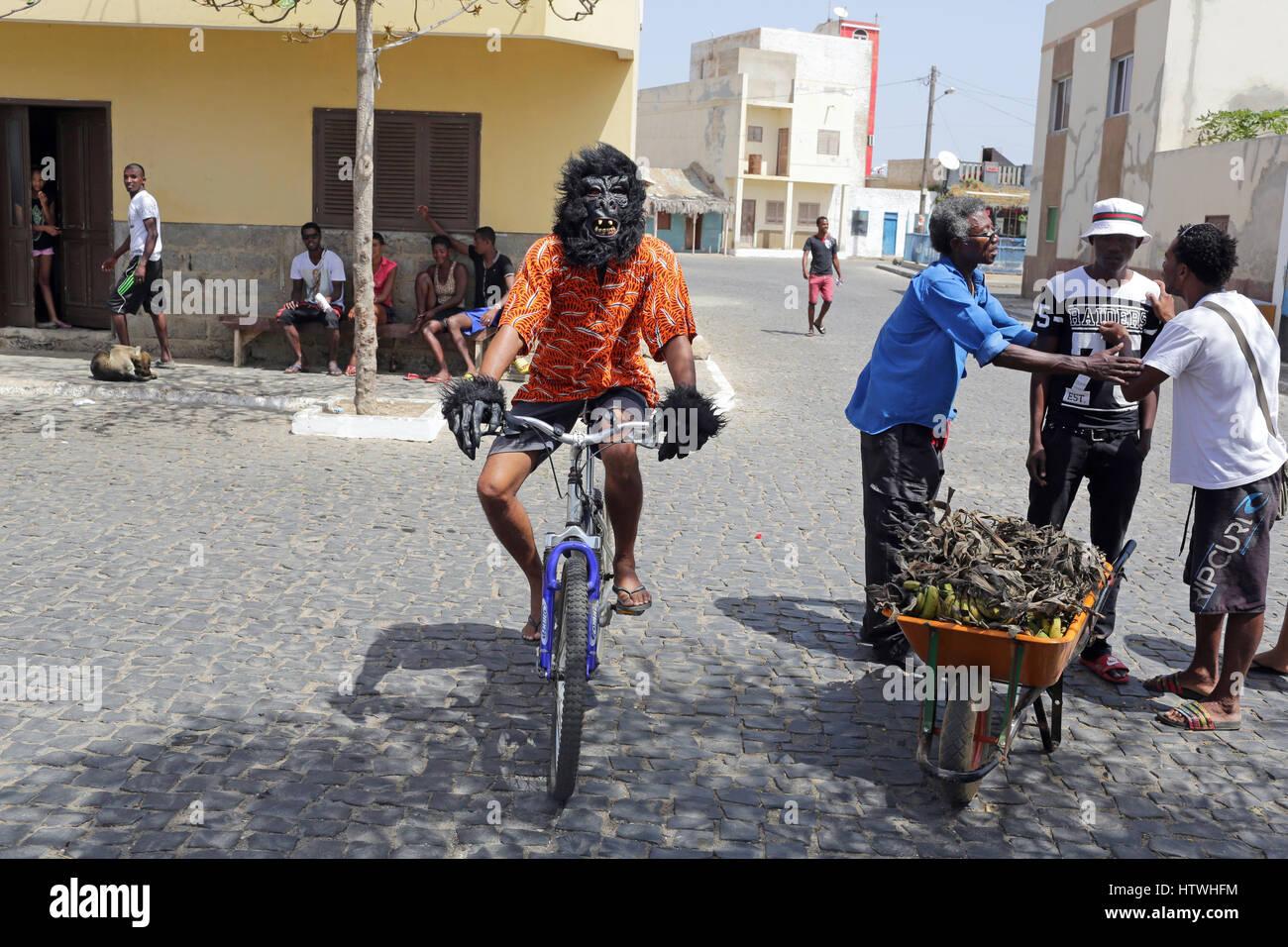 Man dressed as a Gorilla riding a bike - Stock Image