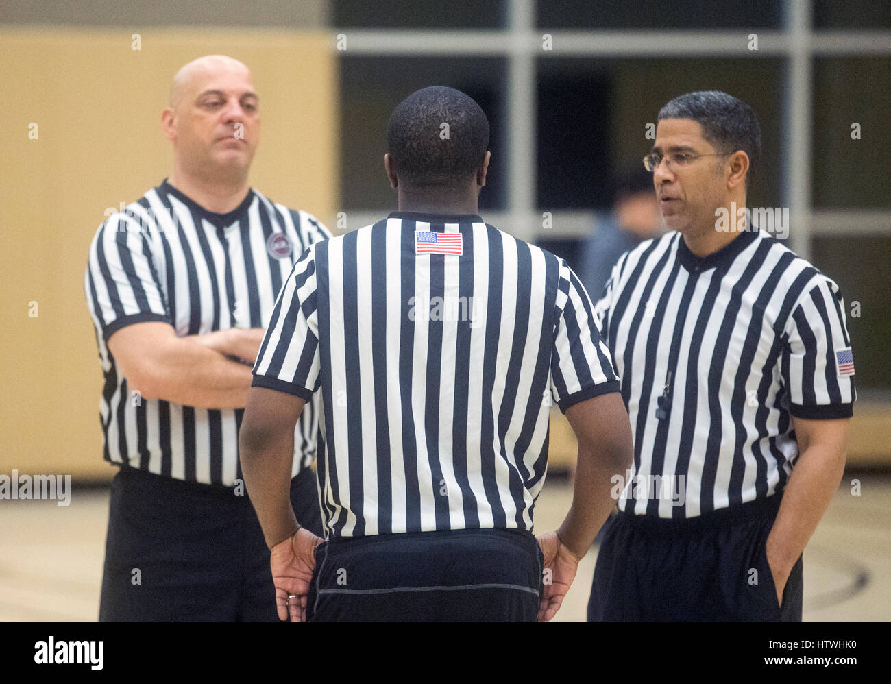 Basketball referees at a game - Stock Image