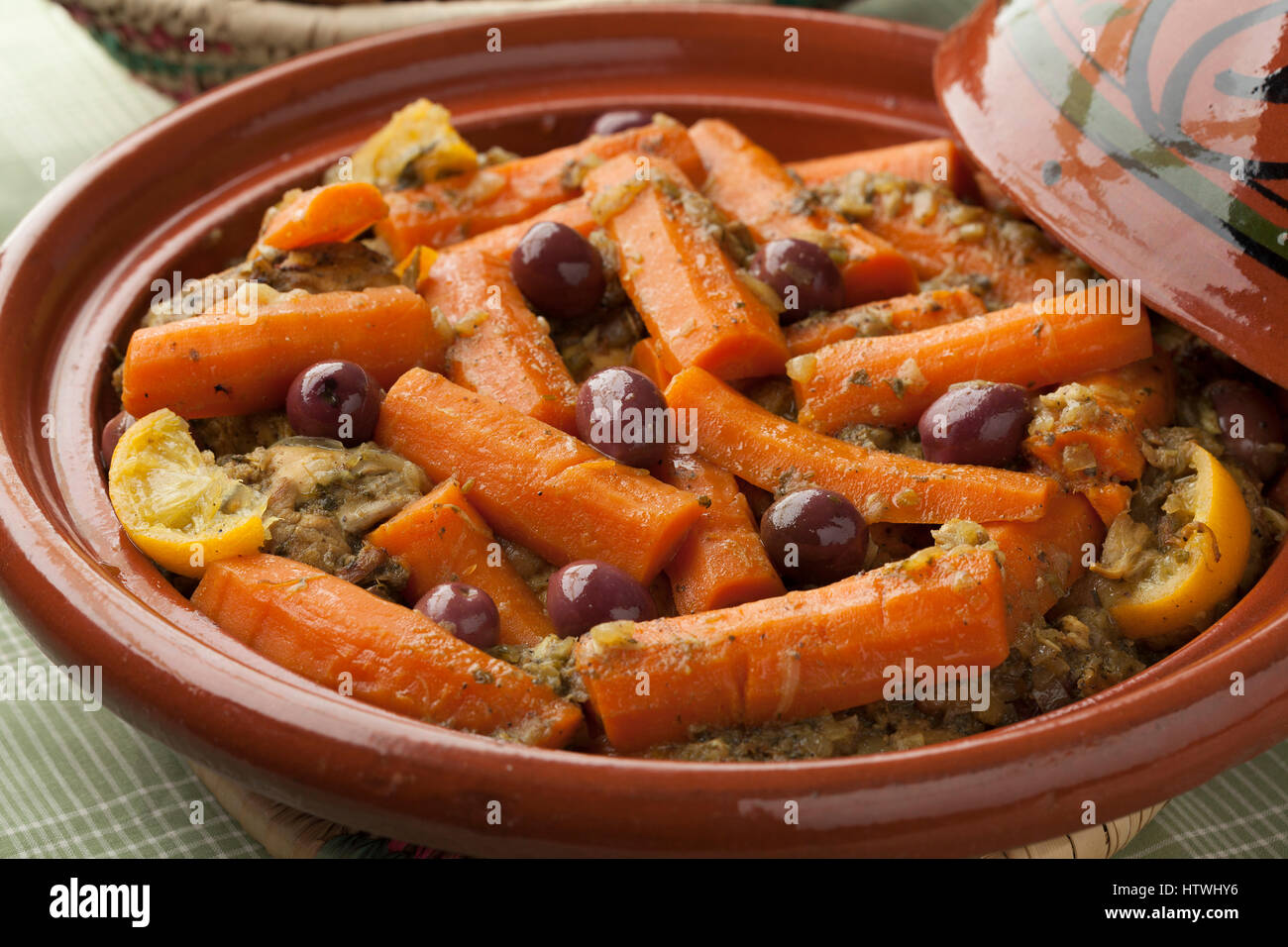 Moroccan tagine with chicken, carrots, olives and preserved lemon close up - Stock Image