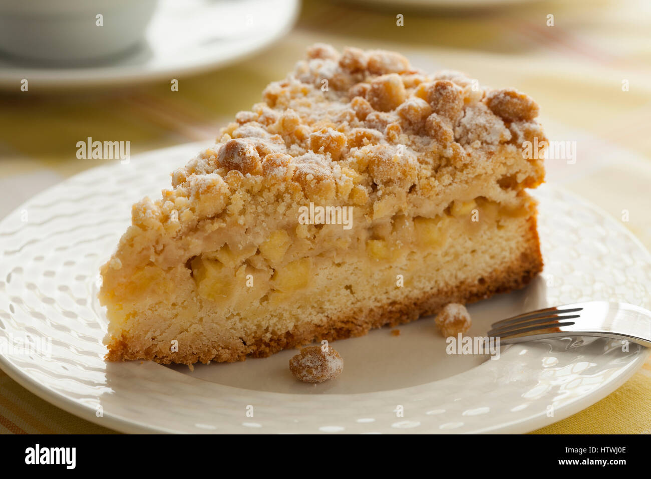 Piece of fresh baked homemade apple cake - Stock Image