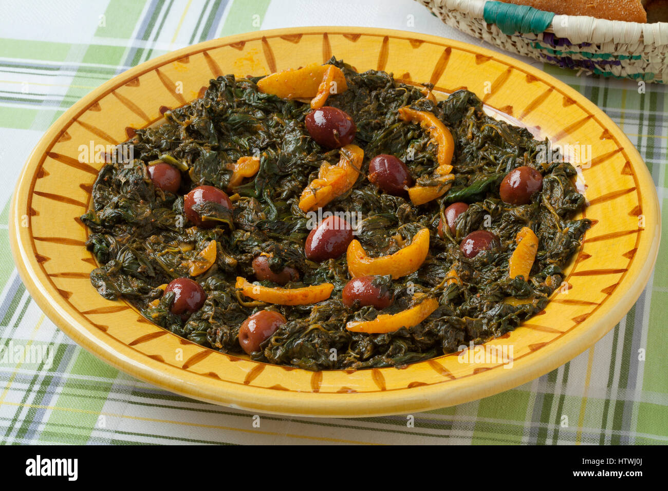 Traditional Moroccan dish with spinach, olives and preserved lemon - Stock Image