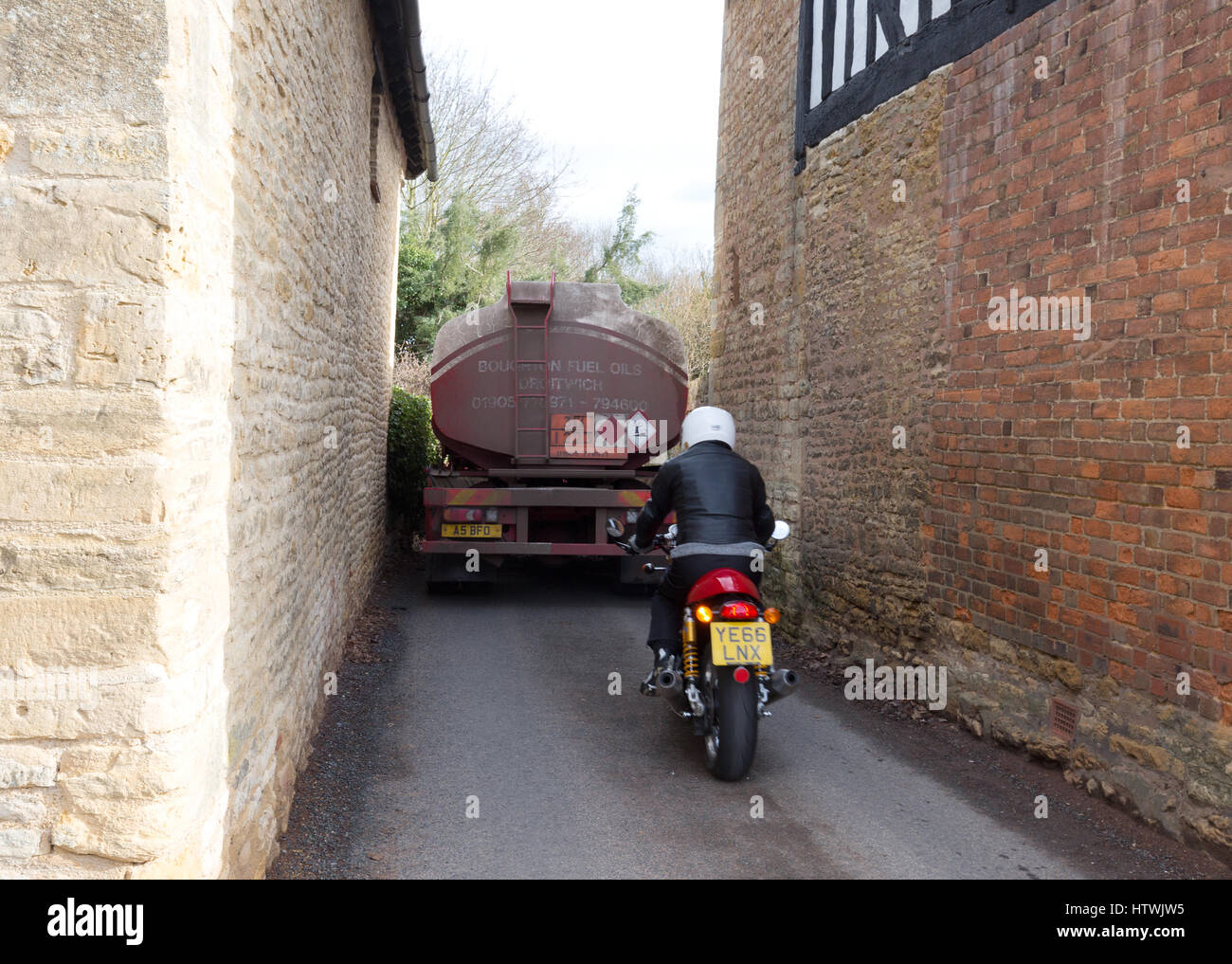 Lorry going down a narrow village road, Elmley Castle village, Worcestershire England UK - Stock Image