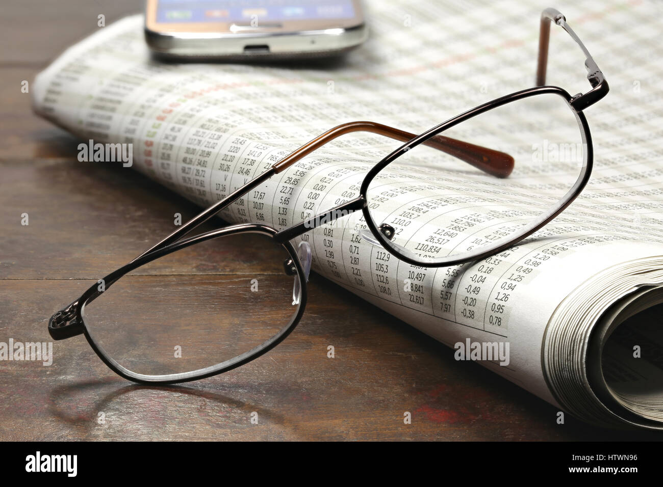 newspaper with stock quotations - Stock Image