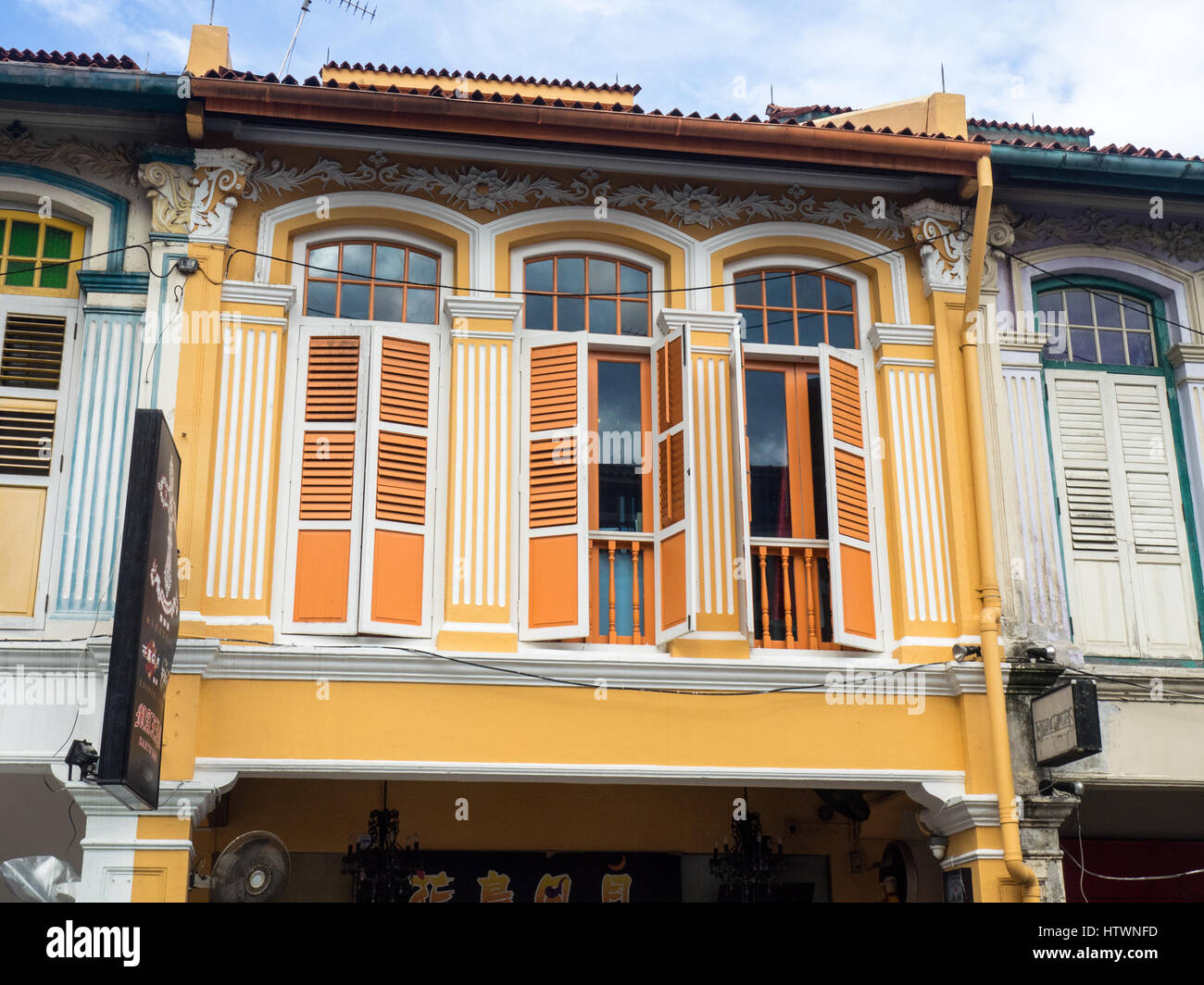 Colourfully painted Singaporean shophouse in Rochor, Singapore. - Stock Image