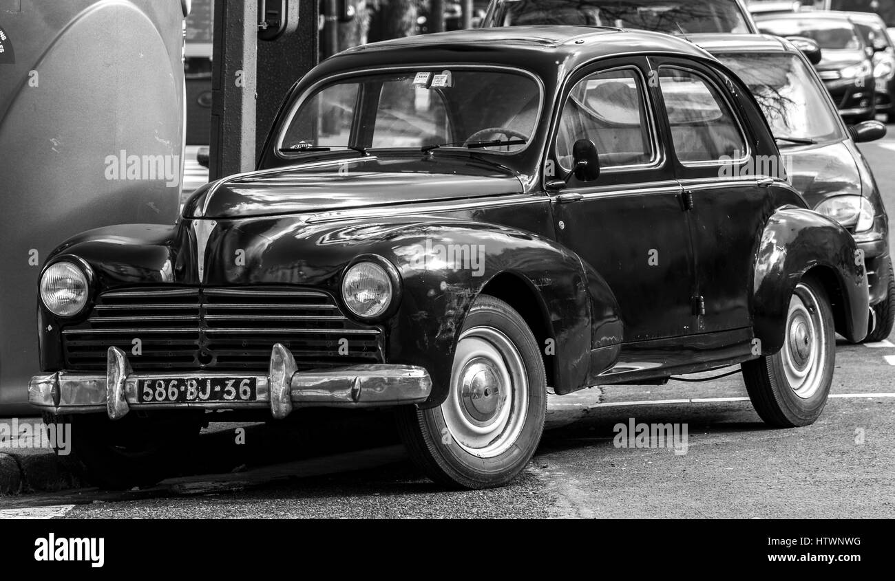 A  old Peugeot 203 parked on a street corner in Paris France. - Stock Image