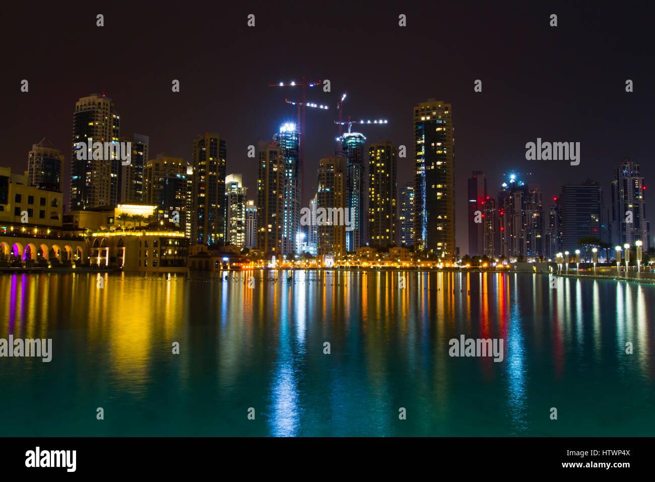 Skyscrapers and Burj Khalifa lake at night. Dubai city.  Dubai. United Arab Emirates. - Stock Image