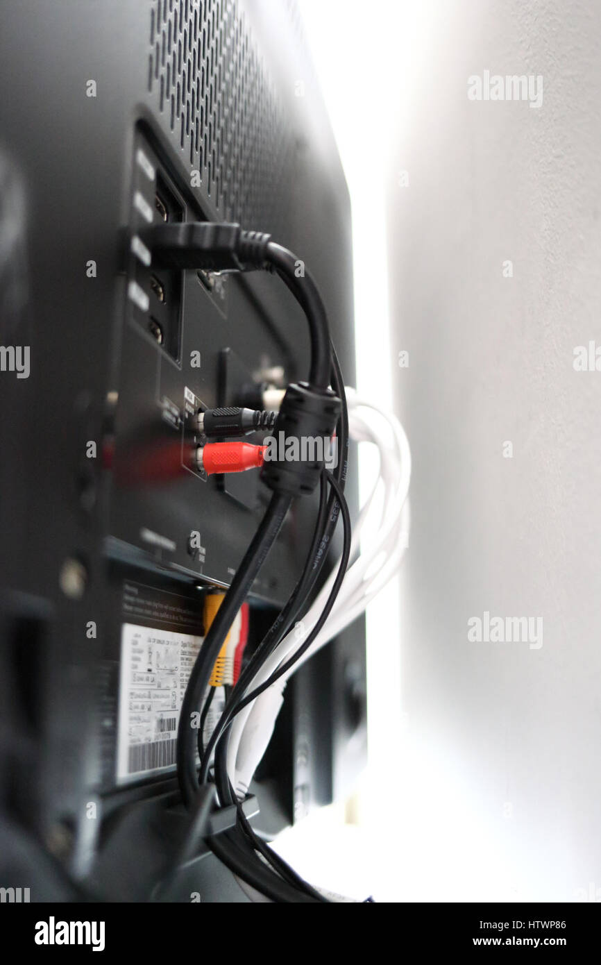 Various cables in the back of a LCD TV Stock Photo