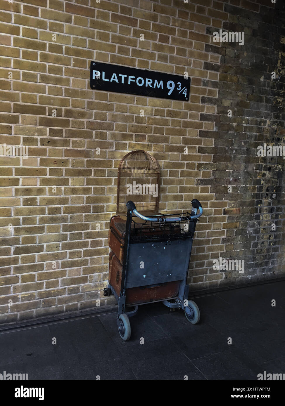Platform ( & 3/4, for the train to Hogwarts School for Wizards, from Harry Potter stories, at King's Cross - Stock Image