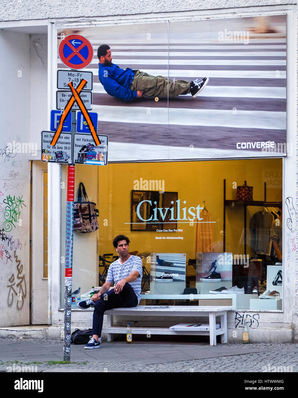 Berlin, Mitte. Civilist shop selling Converse trainers and clothing. Exterior advertisement and display window - Stock Image