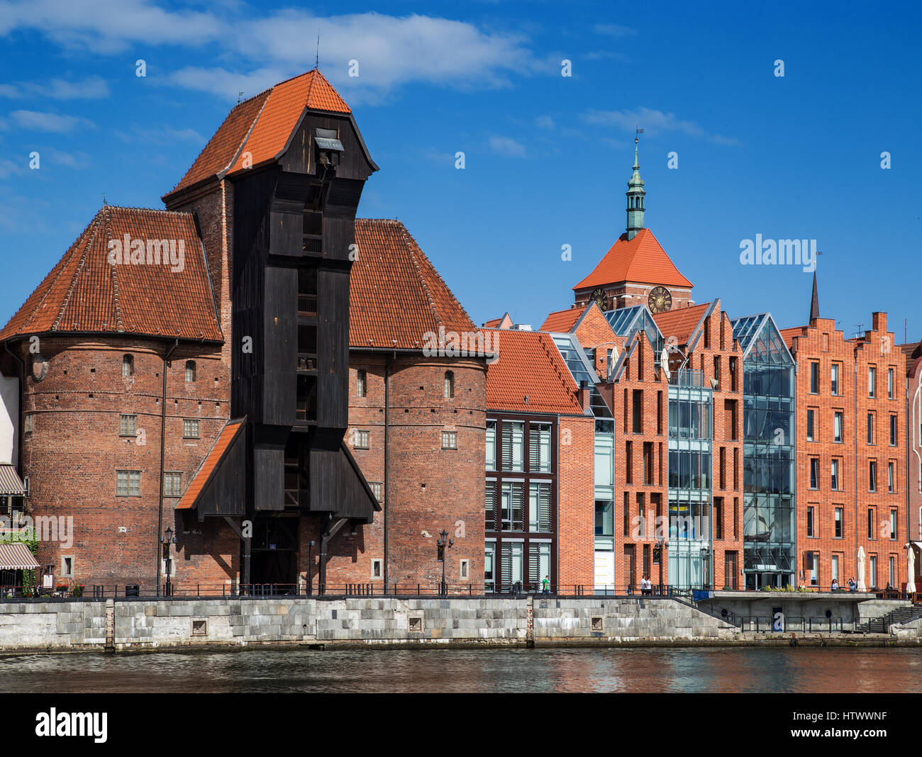 Gdansk, Danzig an old medieval polish and german city, the old granary - Krantor. View on sunny day with blue sky - Stock Image