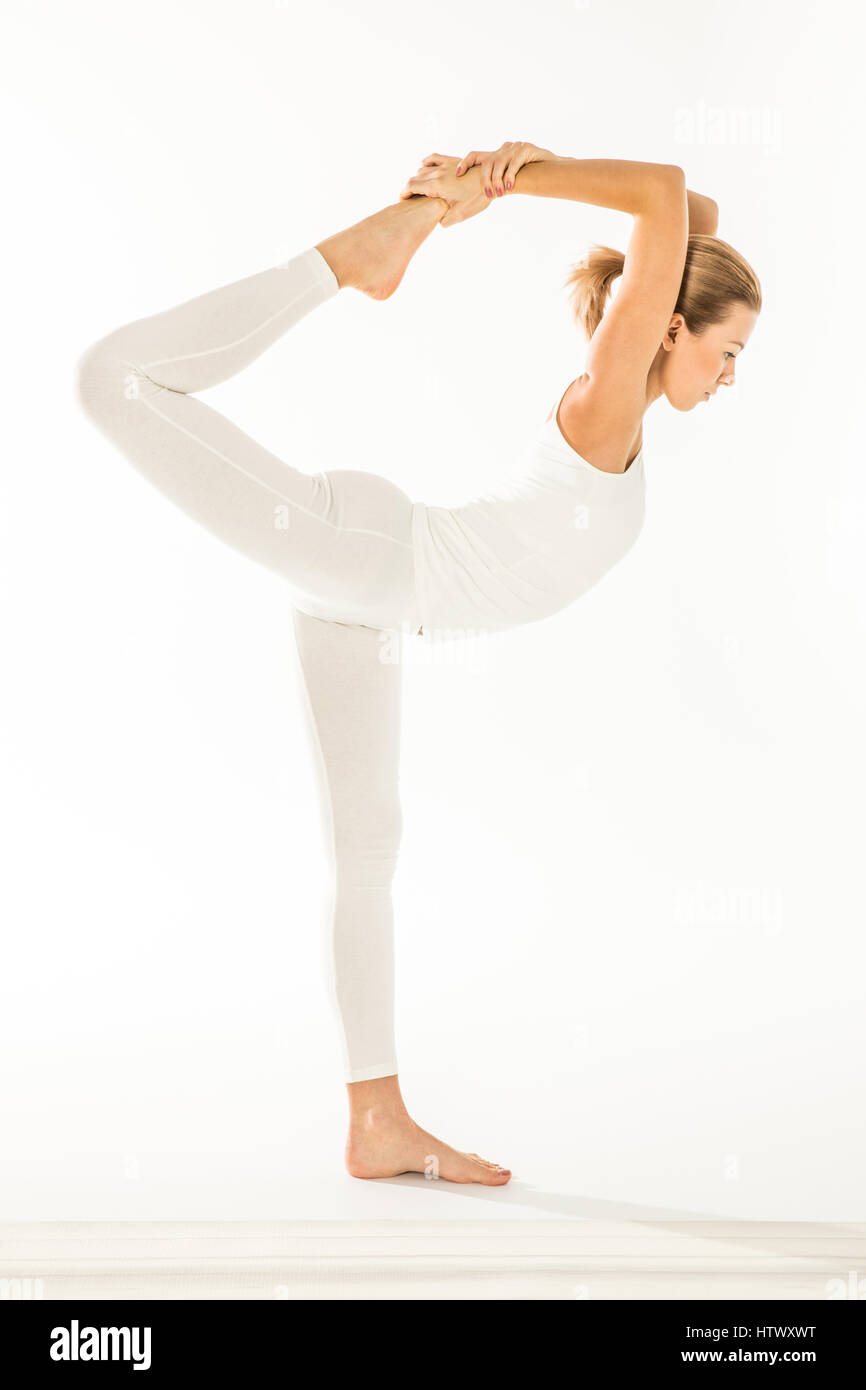 Woman standing in yoga pose  - Stock Image