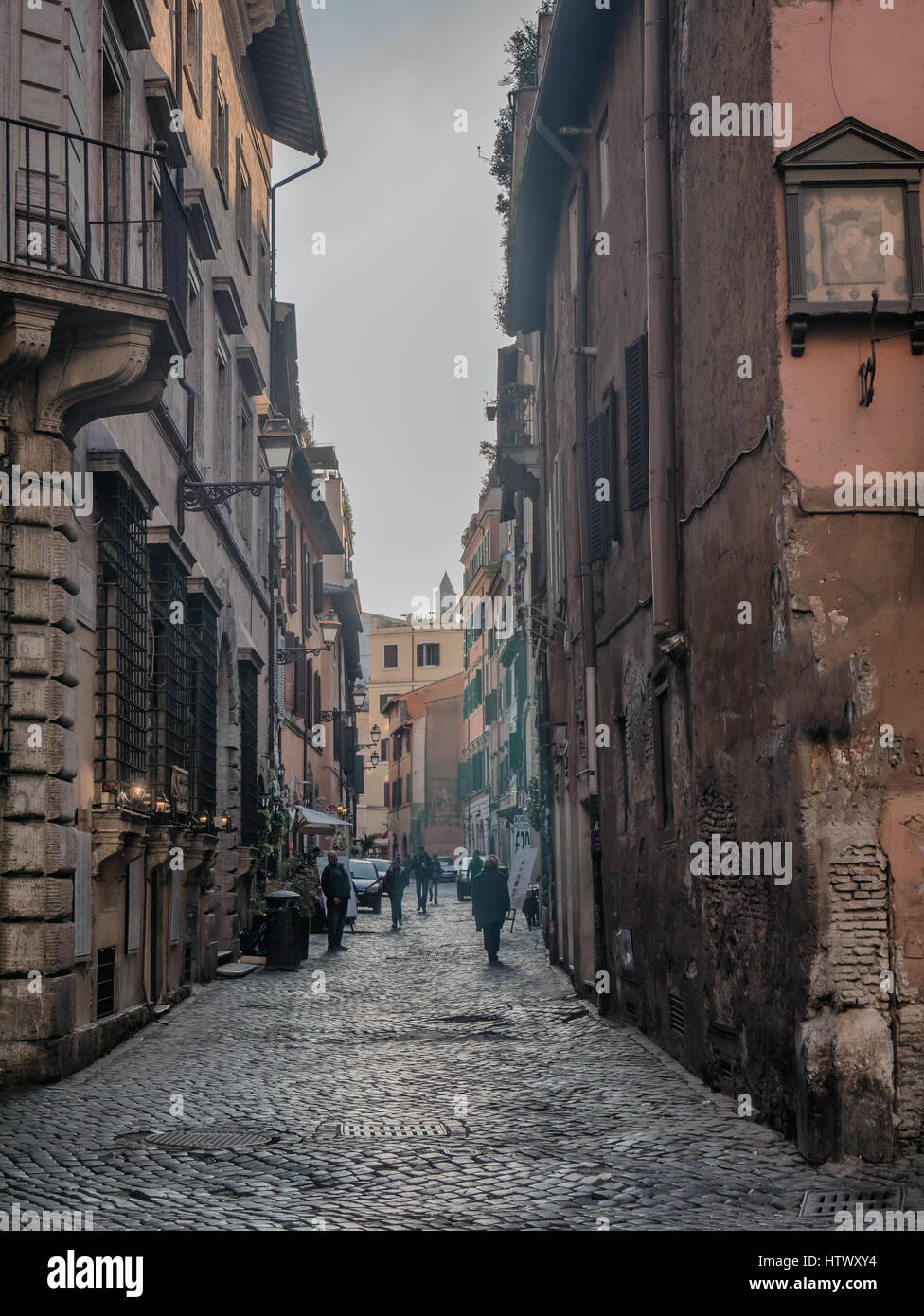 Narrow streets in Rome with restaurants - Stock Image