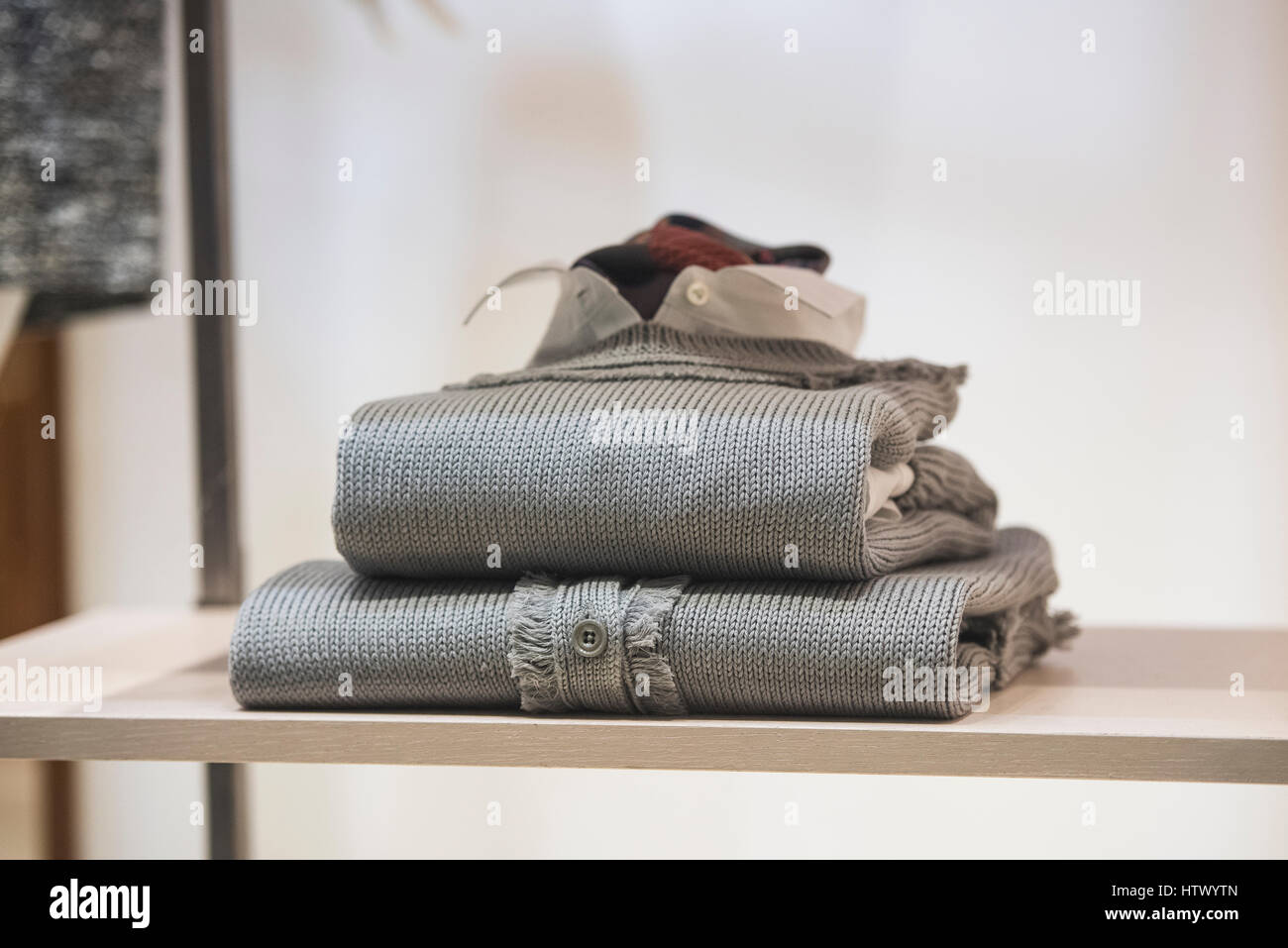 Men clothes on a shelf in a store - Stock Image