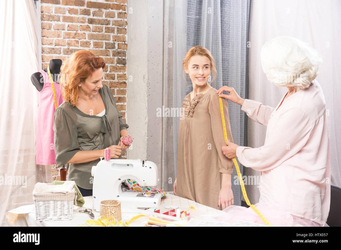 Seamstresses measuring sleeve - Stock Image