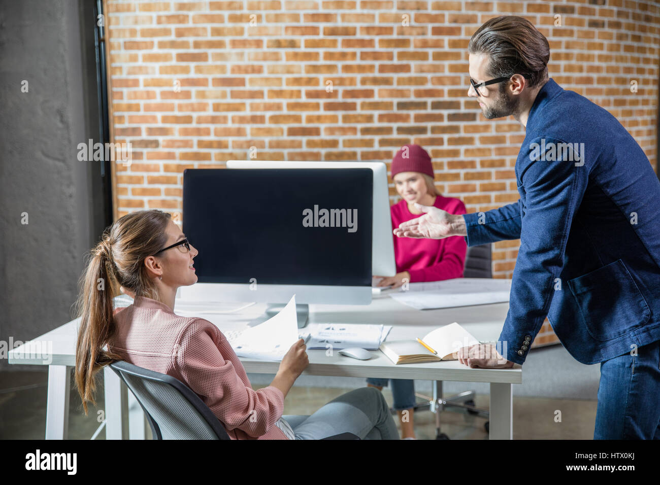 Young people discussing - Stock Image