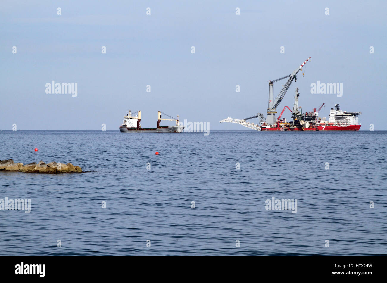 The Seven Borealis (right), a pipe-laying and heavy lift vessel operated by Subsea 7, lying off the coast from Limassol, - Stock Image