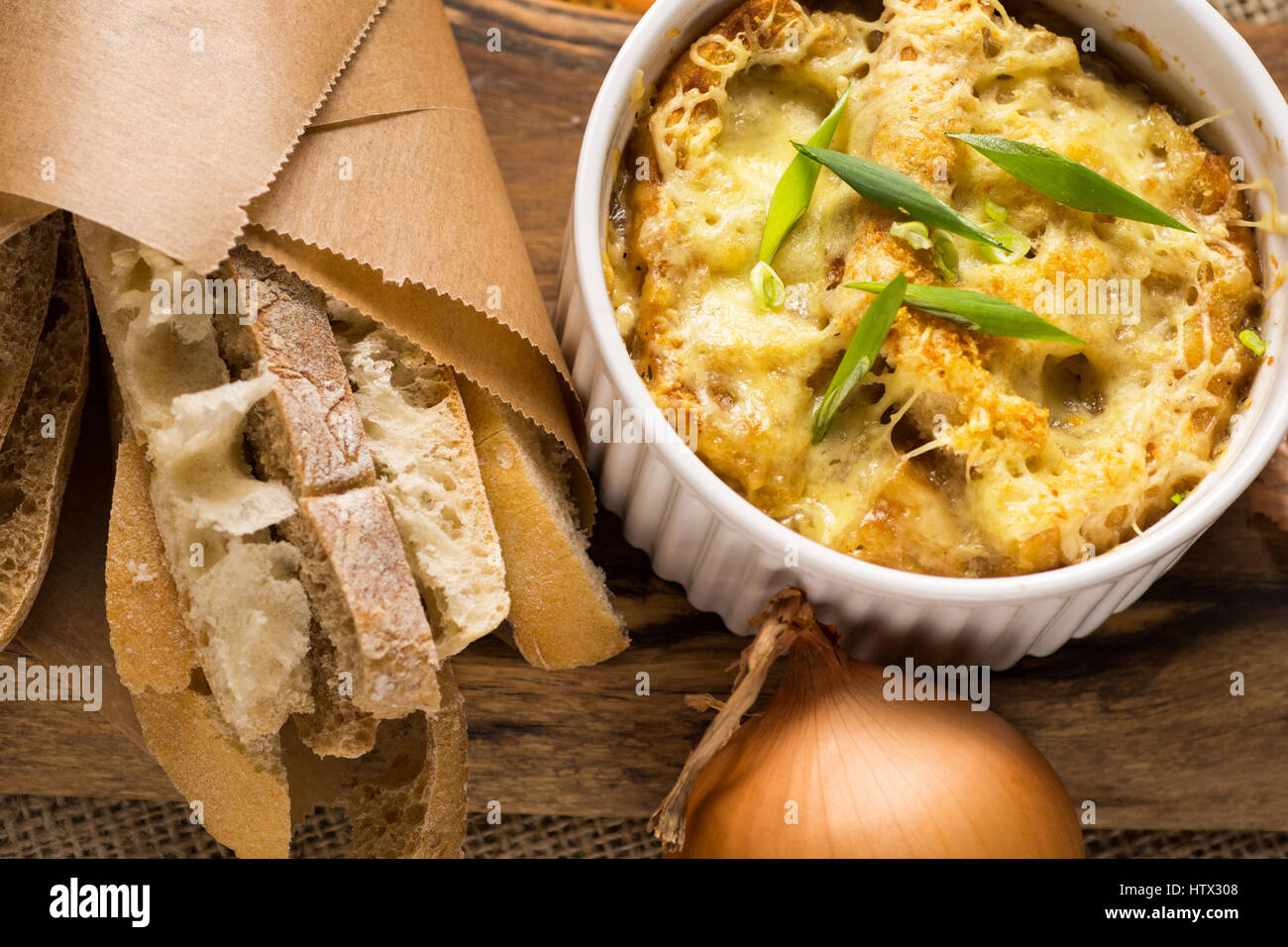 French Onion Soup with Dried Bread and Melted Cheese - Stock Image