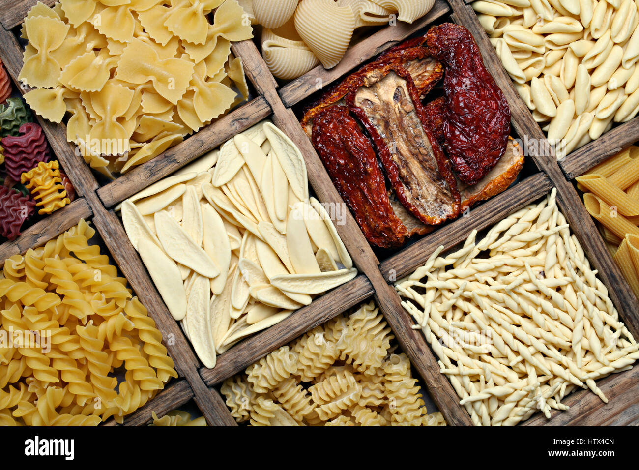 Background image of italian pasta. Various pasta in a wooden antique box - Stock Image