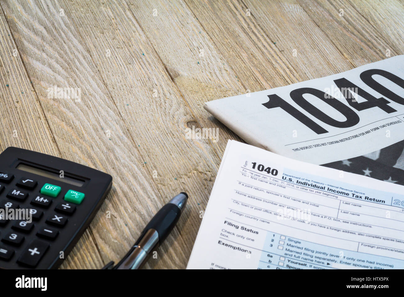 Tax preparation forms and tax booklet US 1040 Tax form - Stock Image