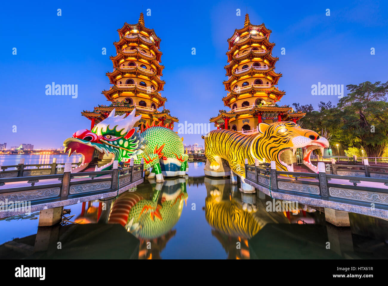 Kaohsiung, Taiwan Lotus Pond's Dragon and Tiger Pagodas at night. - Stock Image