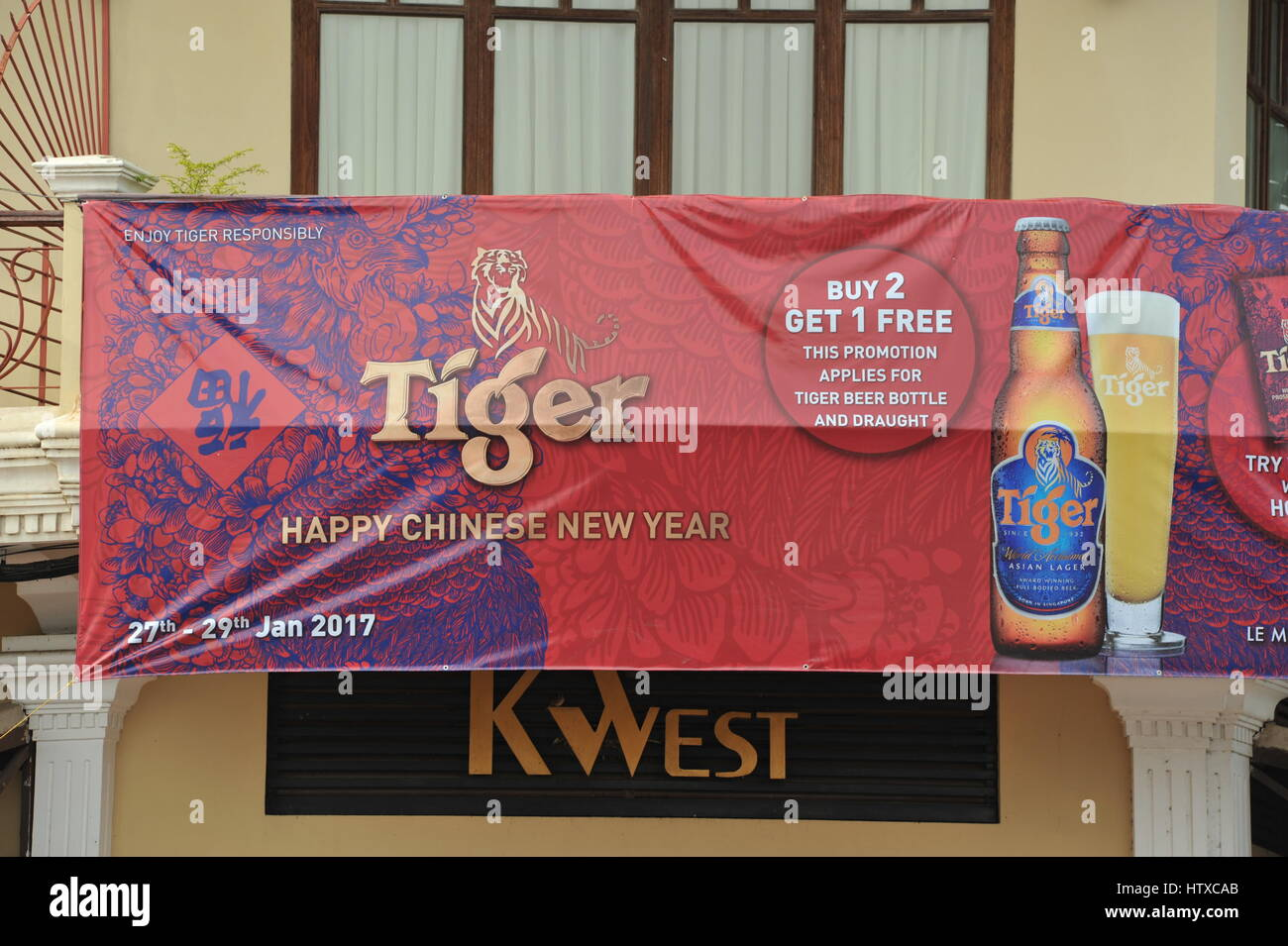 happy chinese new year promotional banner by tiger beer on the riverside phnom penh cambodia credit kraig lieb