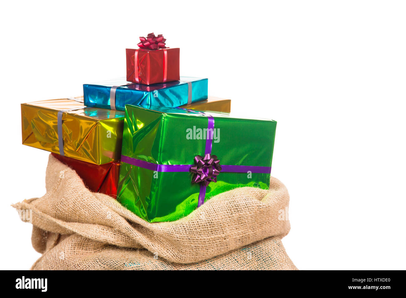 Sack of Sinterklaas with gifts .Isolated on white background. Typical Dutch character part of a traditional event - Stock Image