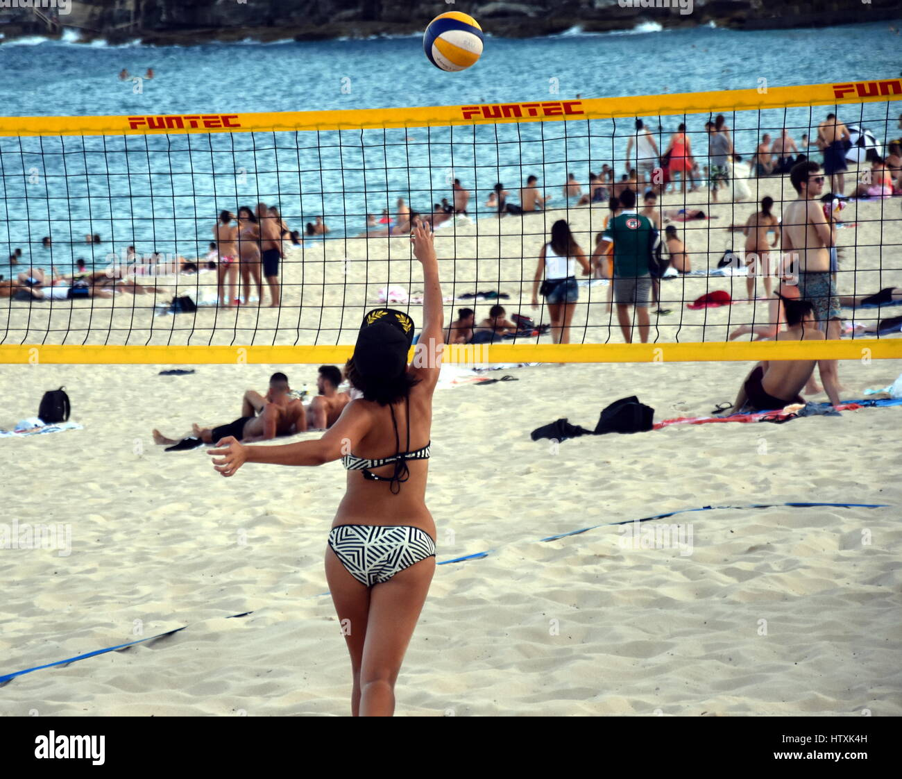 490361a24bb Sydney, Australia - Feb 5, 2017. Girl in bikini playing beach volleyball on
