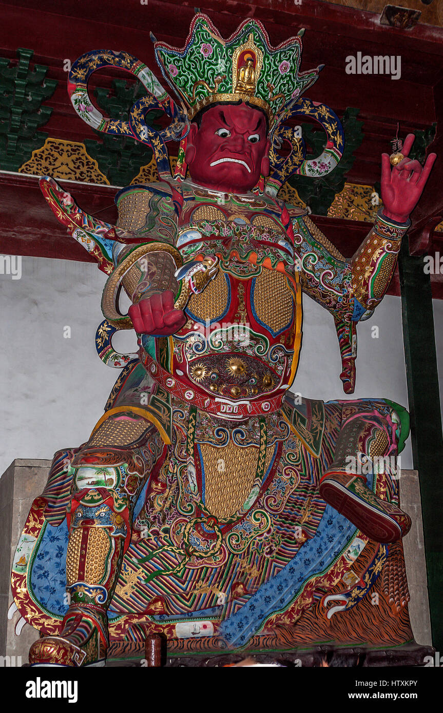 China. Hall of Heavenly Rulers - one of the most important rooms in the Buddhist temples. Statue Vivupaksha with - Stock Image