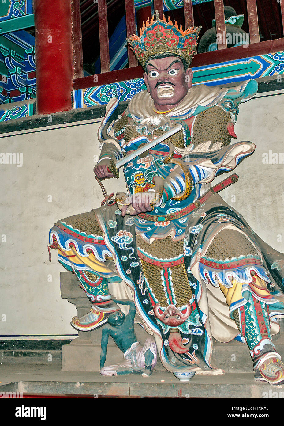 China. Hall of Heavenly Rulers - one of the most important rooms in the Buddhist temples. Statue Virudhaka with - Stock Image