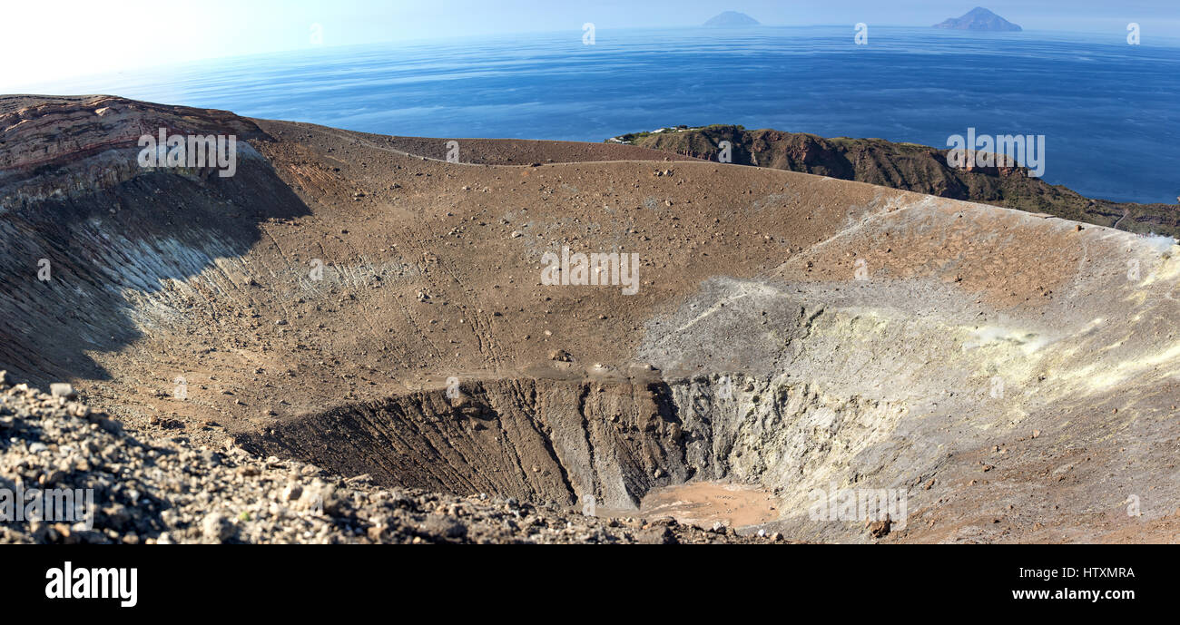 The vulcan Volcano crater, Aeolian Islands. In background Mediterranean Sea and blue sky. Area of Sicily, Italy. - Stock Image